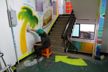 Jacob Halpern painting the stairwell to replicate the CalArts sublevel