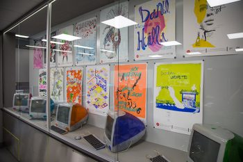 Redcat posters and old iMacs on display in the new MacLab cases