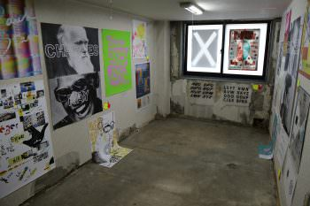 Posters in the gallery space at Common Center