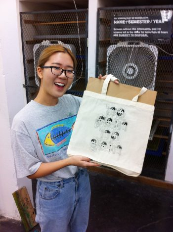 Karen Hong (BFA 3) shows off her tote design