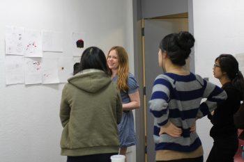 Kim Dulaney critiquing student designsmid-workshop