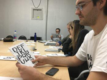 BFA3 Bradley Krebs working on a type project.