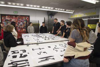 König and workshop participants in CalArts' printlab
