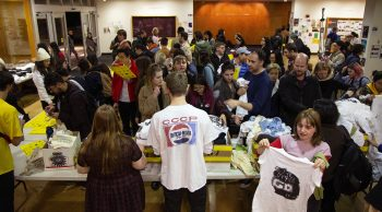 The crowd storming to get their shirts. Photo by Michael Worthington.