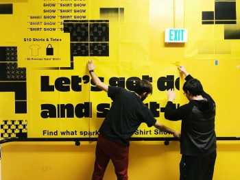 Bryan Gelderbloom and Joe Suh hanging the first poster. Photo by Jessica Peng.