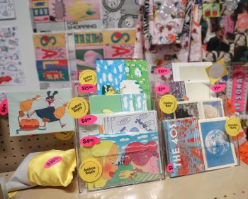 A variety of postcards on sale.
